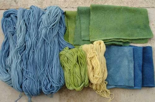 Indigo dyed fibers and fabrics